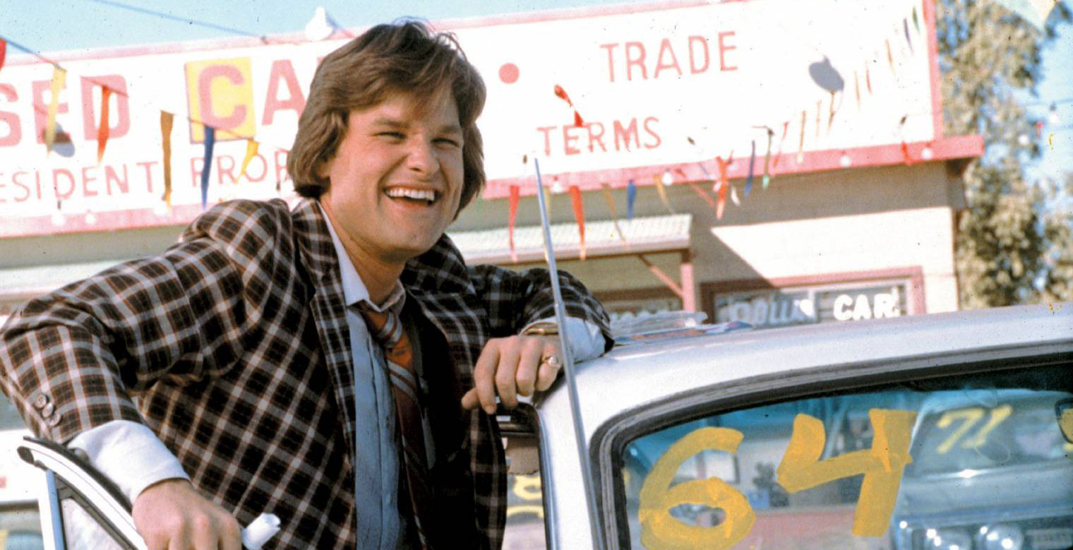 Rudy Russo (Kurt Russel), le vendeur automobile du film Used Cars (Image : Columbia Pictures).